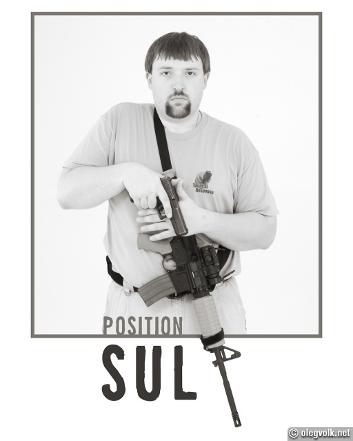 Safe position with rifle and handgun.
